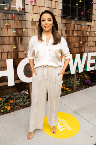 Eva Longoria kept it simple yet stylish in a cream-colored silk blouse at the National Day of Racial Healing.