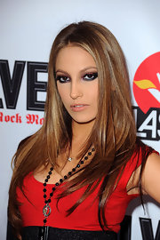 Jenna Haze posed with attitude on the red carpet of the Revolver Golden God Awards with her long straight brunette hair.
