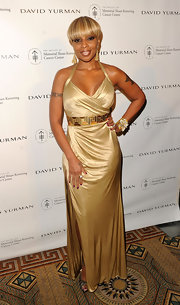 Mary J. Blige was golden in a satiny champagne evening dress with a gilded belt.