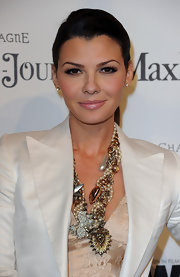 Ali looked very sophisticated in a her sleek ponytail. The classic style made her chunky necklace stand out.