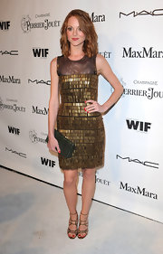Jayma Mays wore a gold brushed metal dress which was very eye-catching. It's a good thing she opted to keep her grey textured clutch simple.
