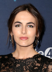 Camilla Belle joined the unite4:humanity event wearing this messy center-parted updo.