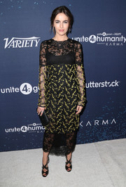 Camilla Belle was goth-chic in a black and yellow lace sheath by Monique Lhuillier at the unite4:humanity event.