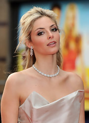 Tamsin Egerton styled her look with a diamond flower necklace.