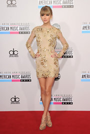 Golden strappy sandals completed Taylor's dazzling look at the 40th AMAs.