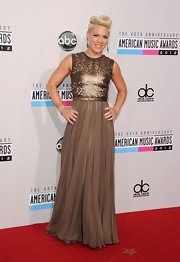 Pink had a major glamour moment on the 2012 AMAs red carpet in this pleated chiffon gown with a laser-cut metallic leather bodice.