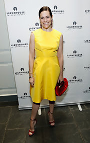 Alexandra Lebenthal chose a canary yellow strapless dress for her classically chic evening look at 'A Posh Affair' gala in NYC.