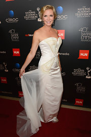 Katherine opted for this chic white column-style dress with gold embroidery and a sheer white train.