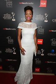 Aisha stunned in an ivory embroidered lace gown that featured delicate cap sleeves and a circular skirt.