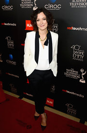 Sara Gilbert sported a chic menswear-inspired white and black tuxedo suit at the Daytime Emmy Awards.
