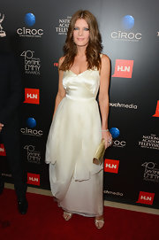 Michelle Stafford opted for a soft and romantic red carpet look with this off-white gown with a draped skirt.