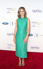 Natalie Morales brightened up the Gracie Awards red carpet with her aqua-green lace dress.