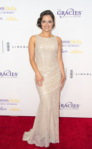 Danica McKellar made an elegant appearance at the Gracie Awards wearing a sleeveless lace gown with a ruched bodice.