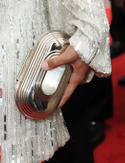 Gabrielle paired her silver sequin dress with a metal box clutch.