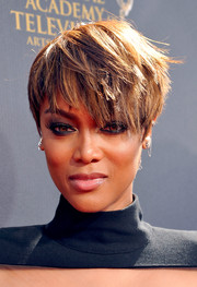 Tyra Banks went majorly edgy with this layered razor cut at the 2015 Daytime Emmy Awards.