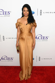 Susan Kelechi Watson looked ultra glam in a gold off-the-shoulder gown at the Gracie Awards.
