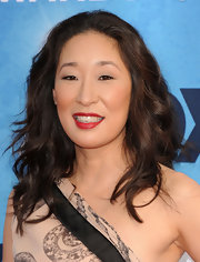 Sandra Oh vamped up her glowing look with a dash of red lipstick.