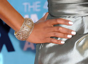 Regina King paired her satin cocktail dress with an ornate bangle bracelet complete with gemstones.