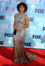 Angell sparkled at the NAACP Image Awards in a backless ombre silver and bronze evening gown.