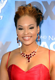 Demetria McKinney paired her sweetheart neckline with a matching gemstone necklace.