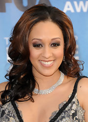 Tia Mowry gave her look a boost with shimmering metallic shadow. Clear lip gloss added the final touch to her look.