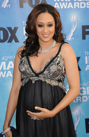 Tia Mowry paired her flowing dress with a diamond clad collar neckalce.