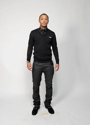 Romeo Miller wore a pair of leather slacks to the NAACP Image Awards. He finished his look off with velvet dress shoes.