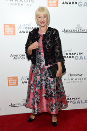 Helen Mirren chose classic black patent Mary Janes for her footwear.