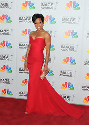 Regina King wore this strapless red gown with a lovely chiffon train to the NAACP Image Awards.