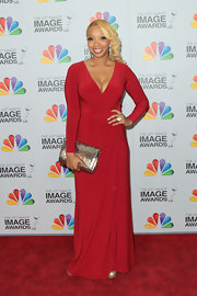 Chef Huda wore this vibrant long-sleeve red gown to the NAACP Image Awards.