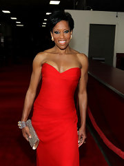 Regina King was all about glamour at the NAACP Image Awards with this bedazzled clutch and strapless gown combo.