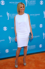 Faith was all-too-chic in her white cocktail dress, which featured draped sleeves. White is such an on trend color for the spring.