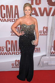 Miranda Lambert accented her bedazzled gown with a glistening silver clutch at the 2011 CMA Awards.