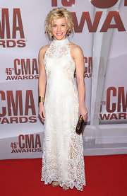 Kimberly Perry of The Band Perry, looked elegant in an embroidered high-neck evening dress. We loved the fresh curled updo but wish she wouldn't have paired the airy style with harsh black accessories.