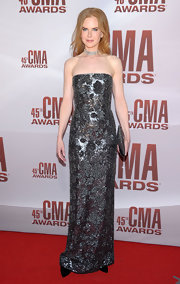 Nicole Kidman wore her signature column dress saturated with gunmetal beading for the CMA Awards.