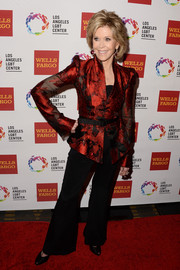 Jane Fonda paired a crimson brocade jacket with flared pants for her Vanguard Awards look.