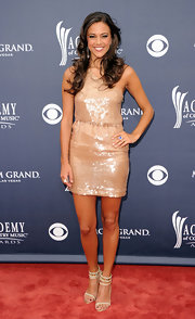Jana shimmered in a peach sequined mini dress at the ACMAs. Sparkling ankle-strap evening sandals completed her look.