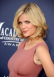 Brooklyn Decker looked sassy on the red carpet at the Academy of Country Music Awards, where she showed off her new mid-length bob. To recreate her face-framing look, begin by blow-drying hair smooth with a round brush. Next, take two-inch sections of hair and curl only the bottom four or five inches with a medium-barreled curling iron. For the finishing touch, quickly tousle and spritz with a product like Fekkai Sheer Hold Hairspray.