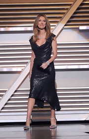 Celine shimmered on stage at the ACMAs in a metallic cocktail dress with a draped neckline.