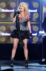 Carrie performed in an edgy Swarovski crystallized design with a bolero jacket for the ACMAs.