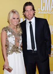 "A dazzling crystal closure enhanced the elegance of Carrie Underwood's gold leather ""Bel Air"" clutch."