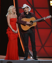 Carrie looked phenom in this strapless red ruched gown on stage at the CMA Awards.