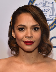 Carmen Ejogo oozed elegance wearing this curly bob at the 2013 NAACP Image Awards.