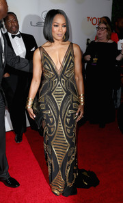 Angela Bassett looked as fierce as ever in an Xcite Xtreme gown featuring geometric gold beading against a black background.