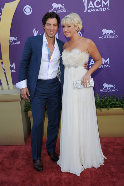 Meghan Linsey looked angelic in this white chiffon chiffon gown with a feathered bust at the Academy of Country Music Awards.