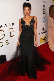 Gabrielle Union channeled her inner pageant queen in a lace-accented black mermaid gown by Rita Vinieris for her NAACP Image Awards look.