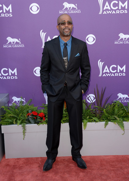 Darius Rucker kept his red carpet look casual but still snazzy with a basic black suit paired with a bright blue shirt.