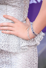 Maggie Rose piled on the bling when she opted for multiple chain-style diamond bracelets.
