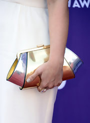 Jaida Dreyer mixed metals when she opted for this gold and silver contemporary-style clutch.