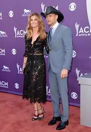 Tim McGraw looked trim and dapper in a pale blue three-piece suit at the ACM red carpet.